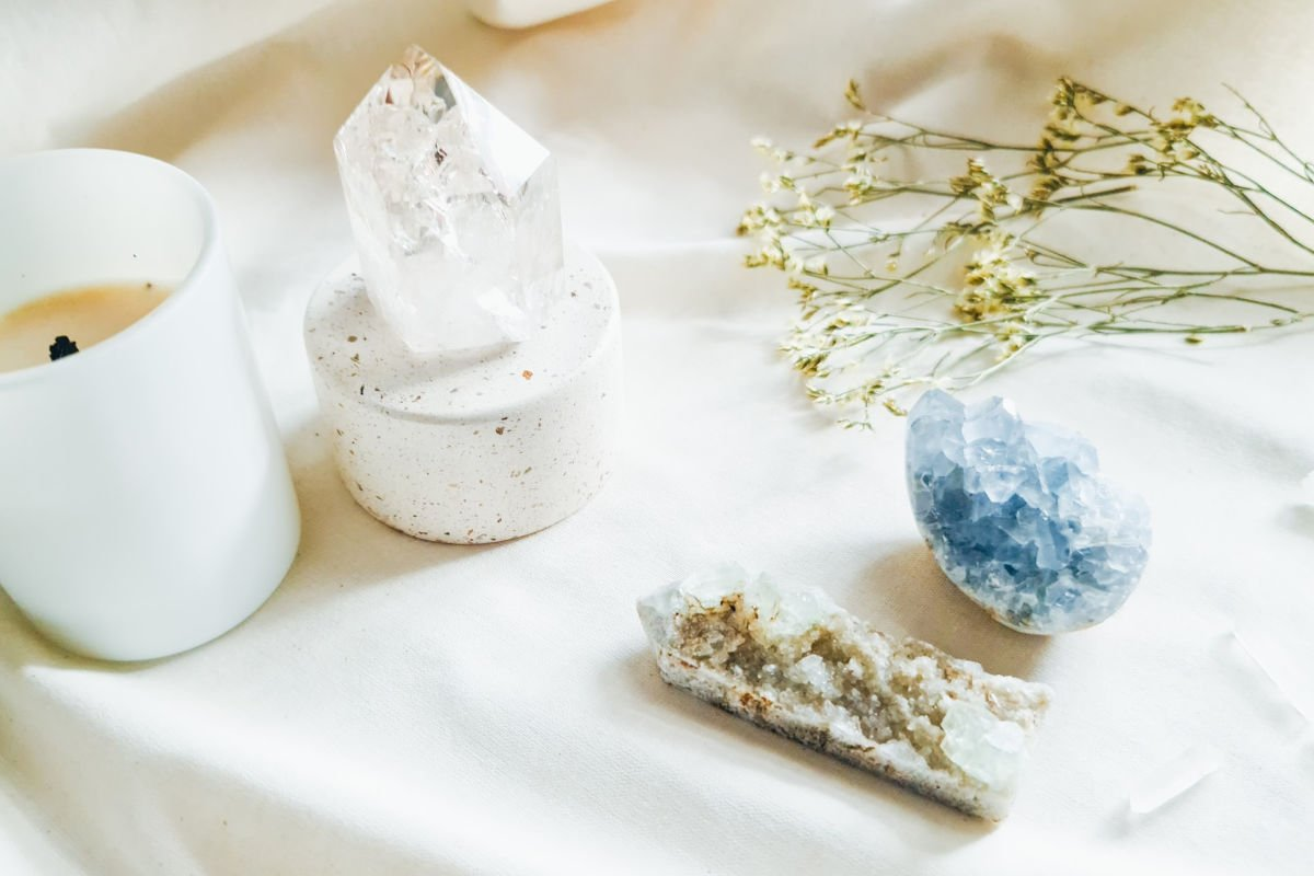 blue crystal, white crystal and candles